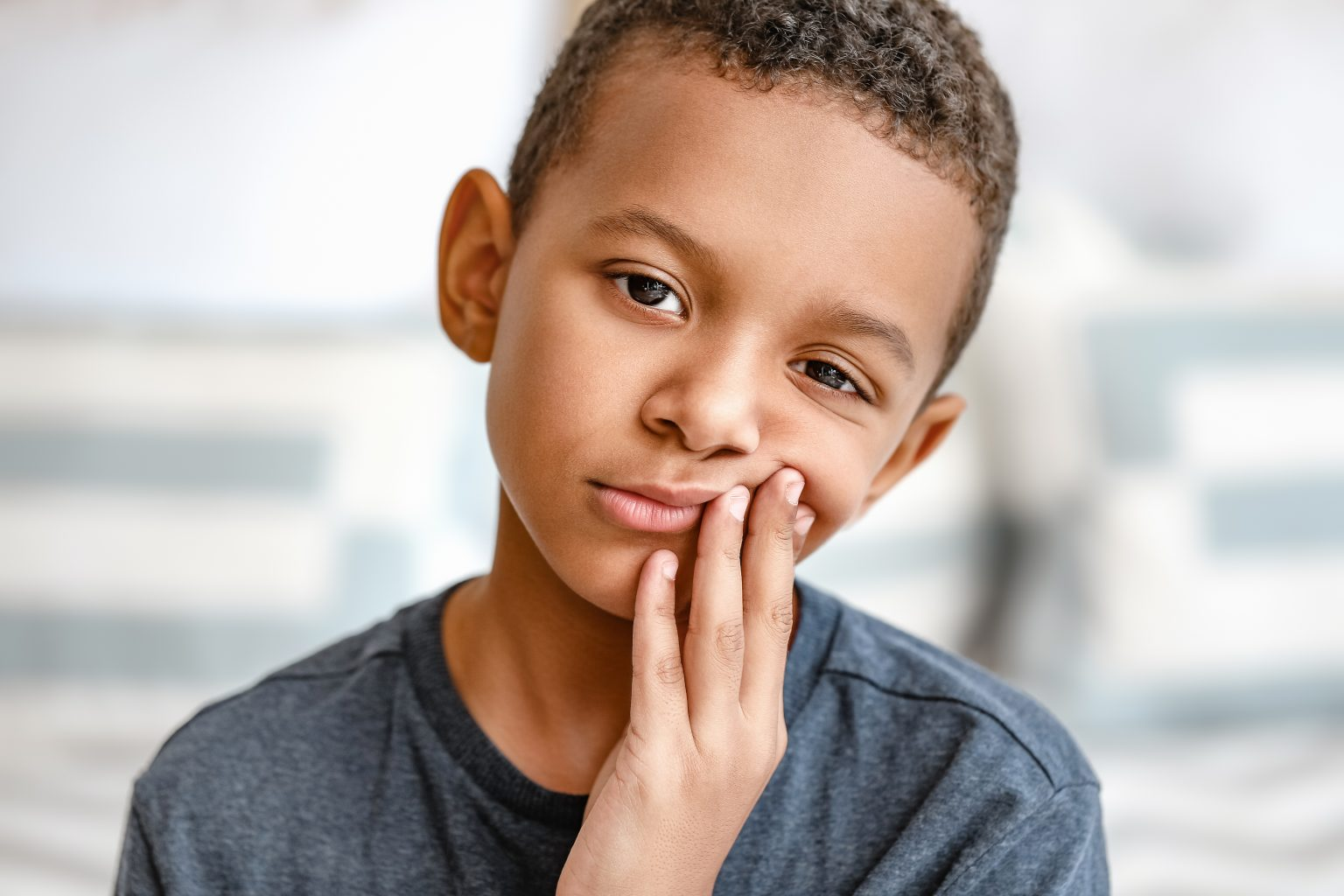 Little African American Boy Suffering From Toothache At Home