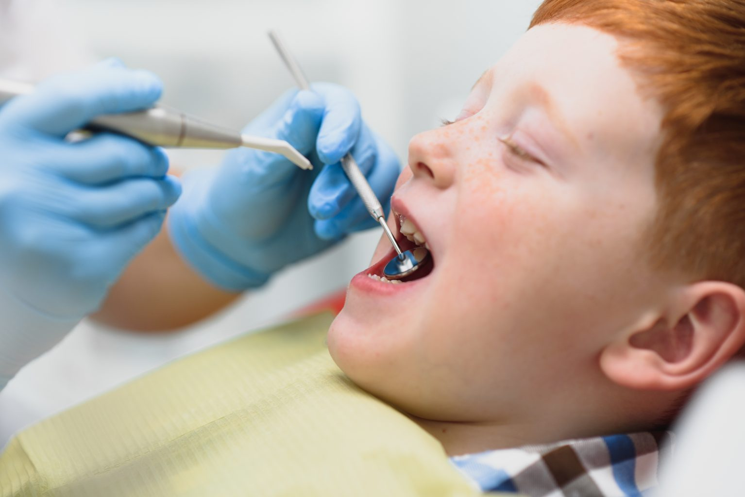 Boy Satisfied With The Service In The Dental Office. Concept Of Pediatric Dental Treatment